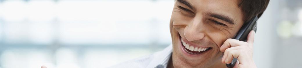 man smiling on the phone - Utstarcom